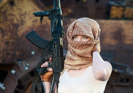 Woman with a gun in the Arab scarf