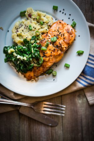Photo for Salmon steak with mashed potatoes and greens - Royalty Free Image