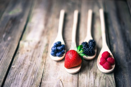 Photo for Berries on wooden rustic background - Royalty Free Image
