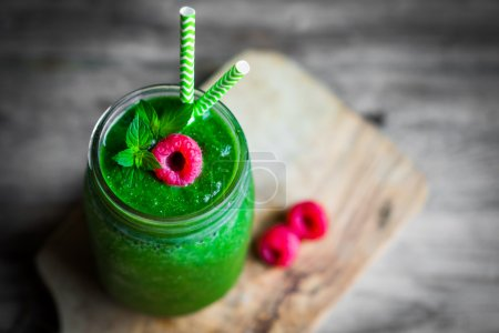 Photo for Fresh green smoothie on rustic wooden background - Royalty Free Image