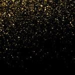 Gold glitter texture on a black background. Golden...