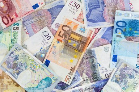 British pounds and euro banknotes background