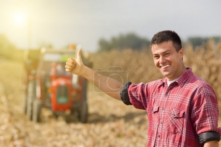 Satisfied farmer in field