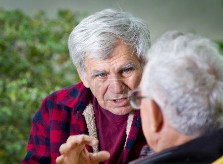 Senior men in park