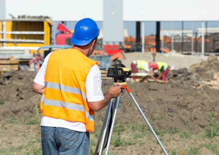 Engineer with theodolite