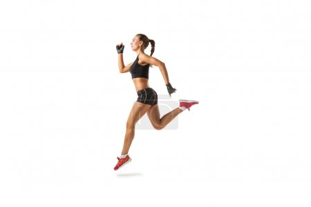 Photo for Athletic woman in sportswear running marathon - Royalty Free Image