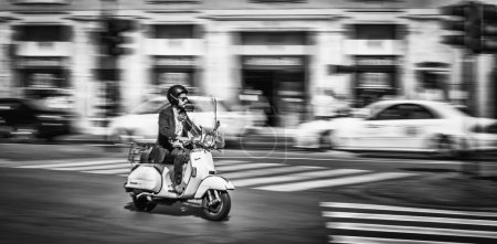 Man Riding Motorcycle at the Street of Rome