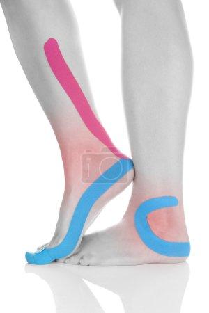 Kinesio tape on female leg.