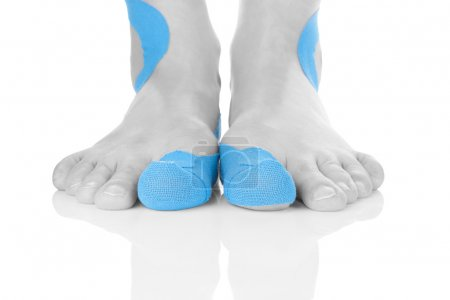 Kinesio tape on female foot.