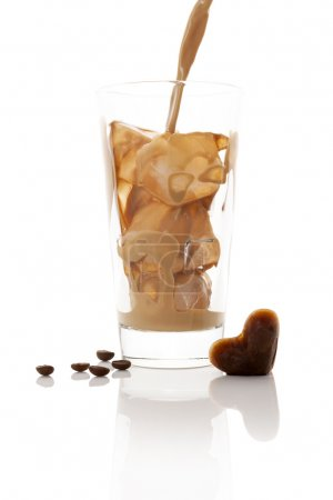Photo for Pouring ice coffee into glass with ice cubes isolated on white background. Culinary coffee drinking. - Royalty Free Image