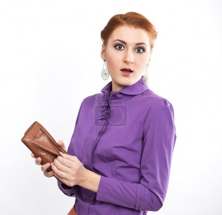 Young red-haired girl with brown purse isolated on white. Business woman. fashion portrait