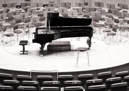 Black piano on the big stage. Philharmonic stage