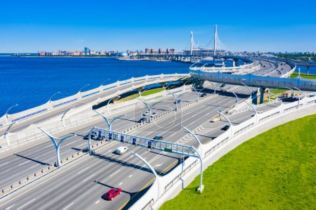 Saint Petersburg. Russia. Concept of modern roads. High-speed roads and a road bridge over the Neva river. Bridges Of St. Petersburg. Vansu bridge. Traffic in a big city.