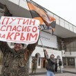 Постер, плакат: Pro Putin activist holds placard at the rally dedicated to Boris Nemtsov murder Voronezh Russia