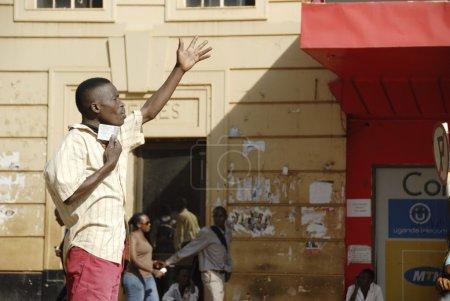 Ugandan man preaches on a street of Kampala, Uganda.