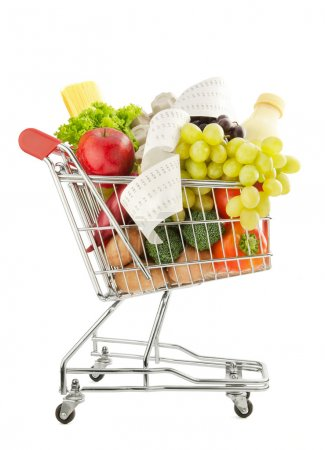 Photo for Shopping trolley full of fresh groceries isolated on a white background - Royalty Free Image