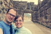 Happy couple posing in front of Lion gate.