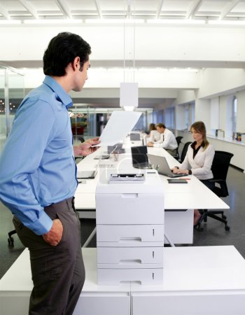 worker with copy machine in office