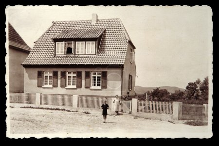 Vintage photo: The family of a soldier in front of their home