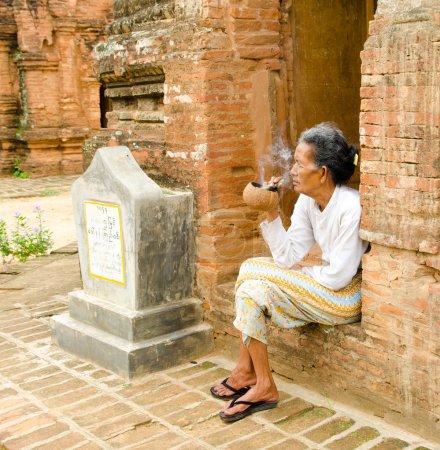 Asiatic old woman smoking
