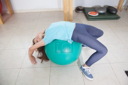 Girl stretching on  ball