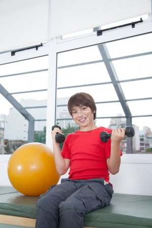 Boy exercising with dumbbells