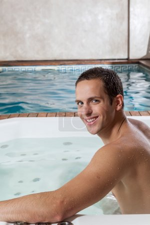 Guy smiling inside a jacuzzi