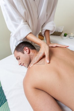 Man laid receiving massage