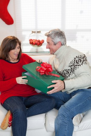 Woman opening the gift that gives her husband