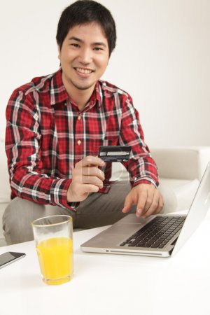Man buying by network and smiling