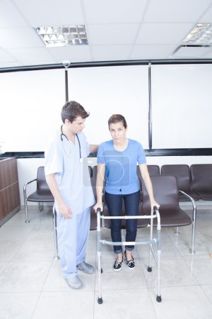 Photo for Male nurse helping a woman with walker - Royalty Free Image