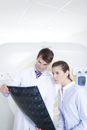 Doctor and patient looking at tomography