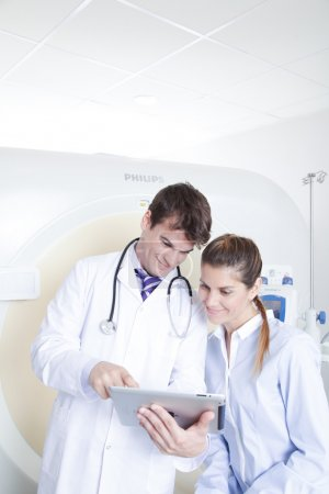 Doctor and patient near tomography scanner