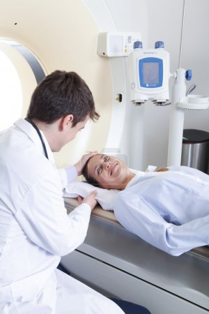 Doctor doing tomography to patient