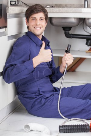plumber showing thumb up