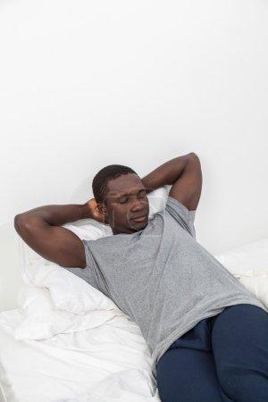 Man relaxing in bed