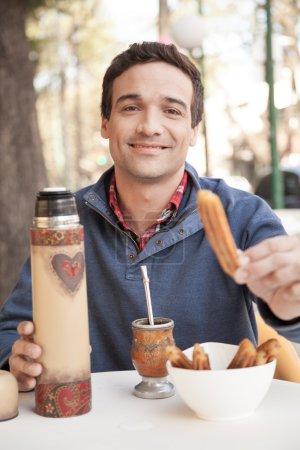 Man eating churro