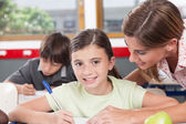 teacher helping a schoolgirl