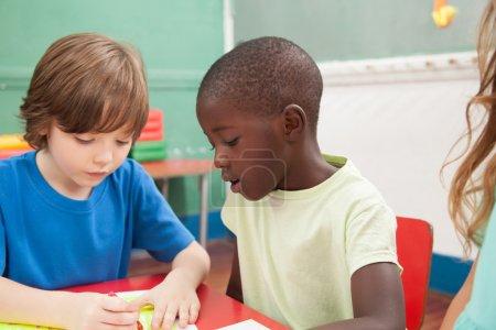 Kids drawing in the kindergarten