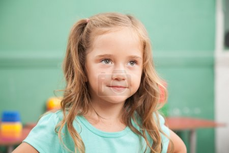 Photo for Pretty girl smiling in kindergarten - Royalty Free Image