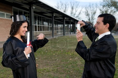 Man taking picture of female student