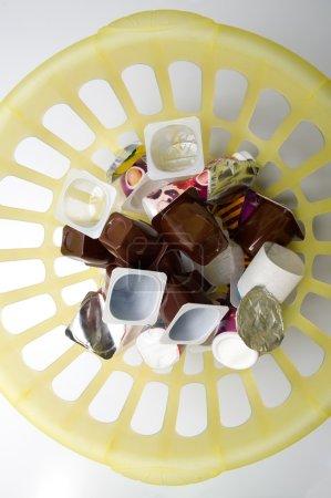 Trash in plastic bin