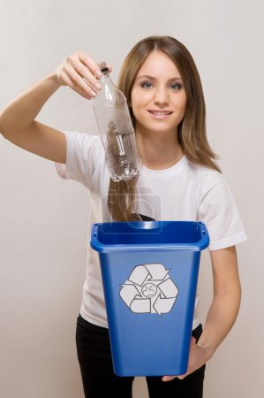 young Woman recycling
