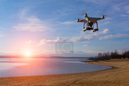 Photo for Modern drone watching the beautiful sunset - Royalty Free Image