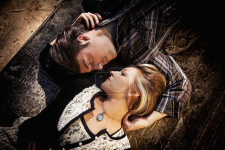 Photo for Couple looking at each other while laying in opposite directions - Royalty Free Image