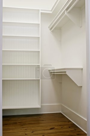Photo for Large white empty walk-in closet with shelves - Royalty Free Image