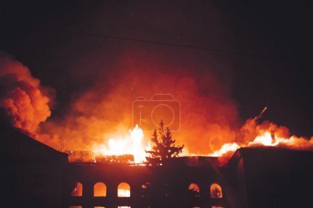 Photo for Tragedy, 911, House On Fire At Night - Royalty Free Image