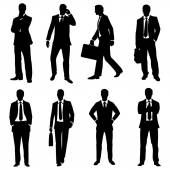 Vector set of silhouettes of business people on white background