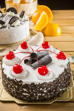 Photo for Cake on a table with sweet cherry - Royalty Free Image