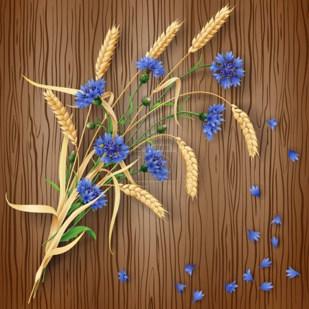 Cornflowers and wheat ears on wood background